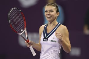 Simona Halep celebrates after defeating Angelique Kerber in their women's singles final match of the Qatar Open tennis tournament in Doha